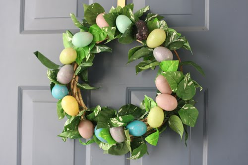 Since I got the eggs, 2 garlands, and the wreath at the Dollar store (and already had hot glue, wire, and wire cutters on hand), the project cost me a total ...