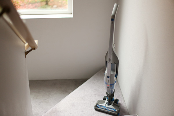 Hoover 2-in-1 cordless vacuum on stairs