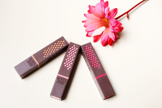 Burt's Bees lipsticks array with flower