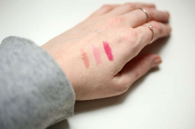 Burt's Bees lipstick swatches on hand, fair skin