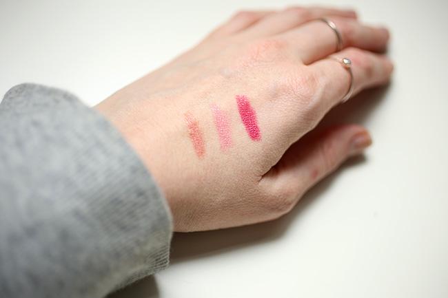 Burt's Bees lipstick swatches on hand, fair skin