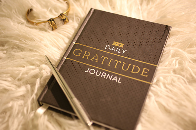 Gratitude Journal on faux fur footstool with pen and DIY gold bangle