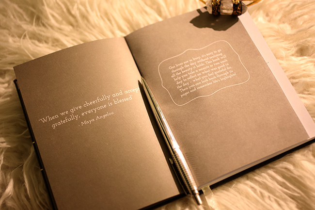 Gratitude Journal on faux fur footstool with pen and DIY gold bangle, open to quote pages
